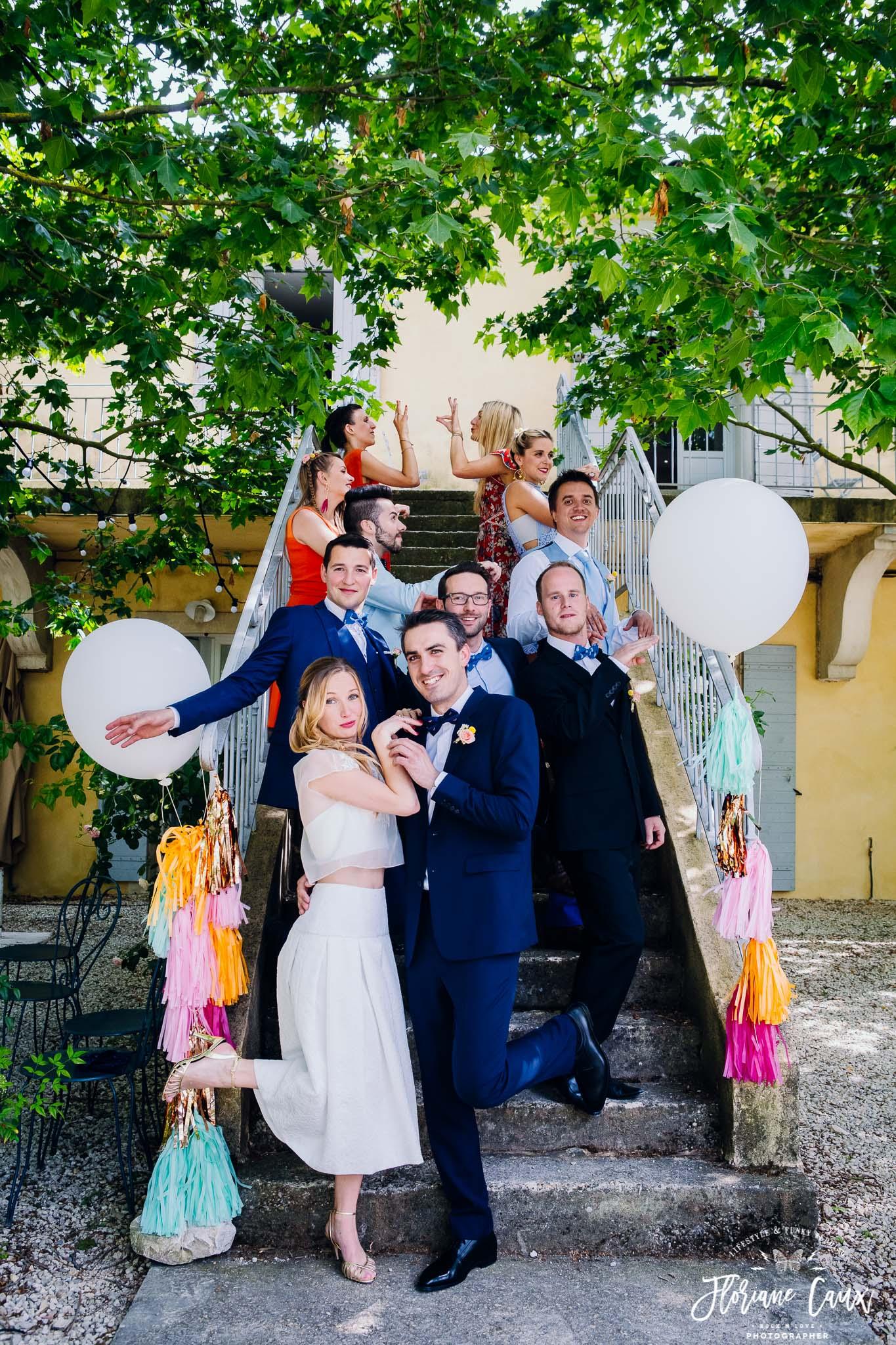 photo de groupe mariage flamand rose